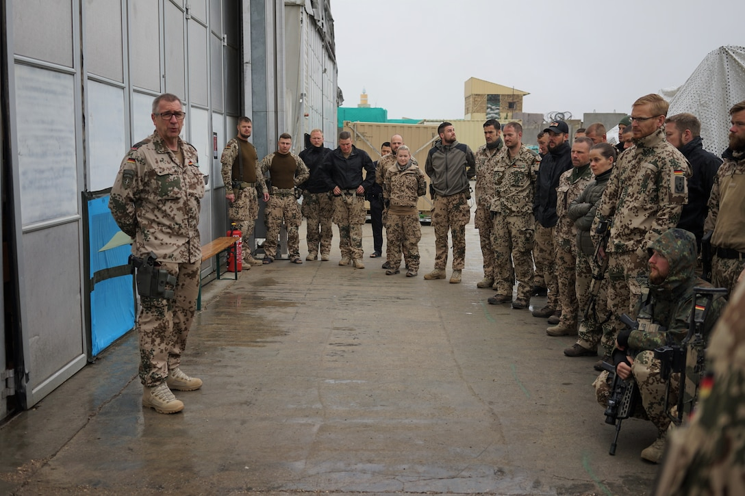 German Army Col. Christoph Böcker, Senior Advisor at Maimanah, speaks to German Army soldiers at the Afghan National Army base in Maimanah, Faryab province. The German-led Train, Advise, Assist Command-North advising teams are in Maimanah to ensure better coordination of operations against insurgents and terrorists who spark instability in the region. (Courtesy photo)