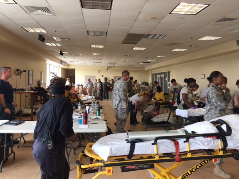 Members of a U.S. Air Force En Route Patient Staging System team from the 375th Medical Group based at Scott Air Force Base, Illinois, set up an aeromedical staging location for Hurricane Maria relief efforts after arriving at Henry E. Rohlsen Airport, near Christiansted on St. Croix, U.S. Virgin Islands, Sept. 23, 2017. (Photo by Lt. Col. Elizabeth Anderson-Doze)