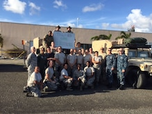 Members of a U.S. Air Force En Route Patient Staging System team, made up of Airmen from the 375th Medical Group from Scott Air Force Base and members of U.S. Transportation Command, pose for a photo on Oct. 4, 2017, at the end of a deployment following Hurricane Maria in St. Croix, U.S. Virgin Islands. (Photo by Lt. Col. Elizabeth Anderson-Doze)