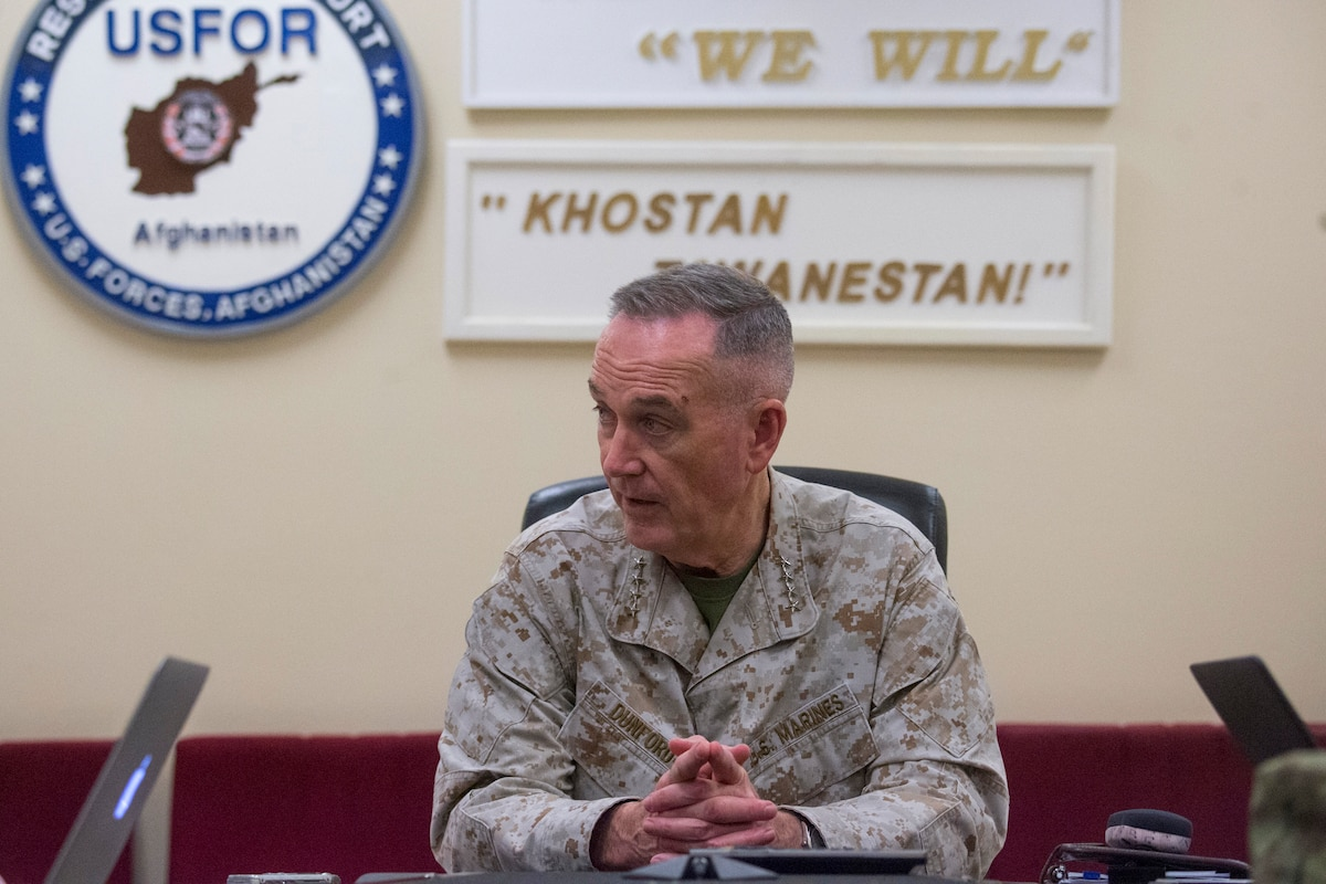 Marine Corps Gen. Joe Dunford, chairman of the Joint Chiefs of Staff, sits at a table.