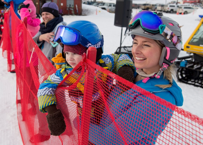 Personnel and families take part in the 2018 Slush Cup at the Joint Base Elmendorf-Richardson Hillberg Ski Area, March 18, 2018. The Slush Cup is a two-fold annual event celebrating the change in weather, consisting of skiers and snowboarders trying to make it across a man-made slush pond without falling.