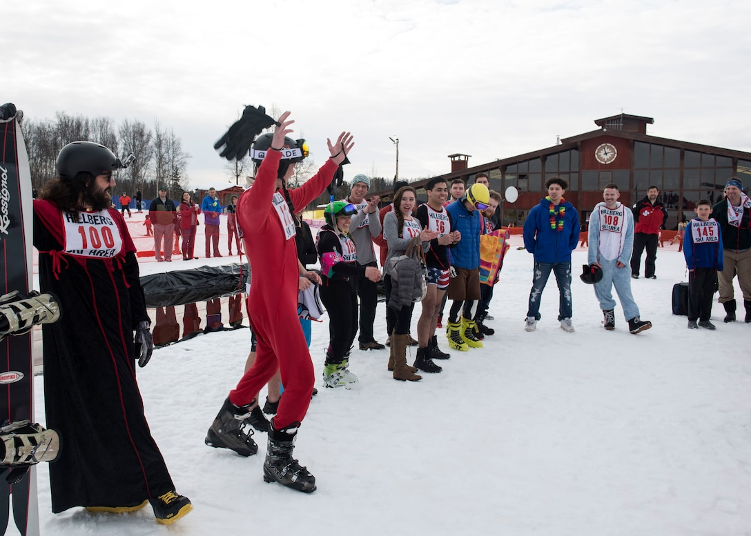 The 2018 Slush Cup participants congratulate the winners at the Joint Base Elmendorf-Richardson Hillberg Ski Area, March 18, 2018.The Slush Cup is a two-fold annual event celebrating the change in weather, consisting of skiers and snowboarders trying to make it across a man-made slush pond without falling. This year included Best Splash and Best overall categories as well as second and third place winners.