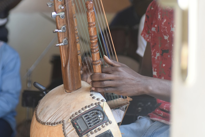 A student plays the kora at the National School of the Arts in Dakar, Senegal, March 21, 2018. The student performed for an audience of fellow students and the U.S. Air Forces in Europe Band, who are in Dakar to support African Partnership Flight Senegal, a military-to-military event focusing on improving professional military aviation knowledge and skills. (U.S. Air Force photo by Airman 1st Class Eli Chevalier)