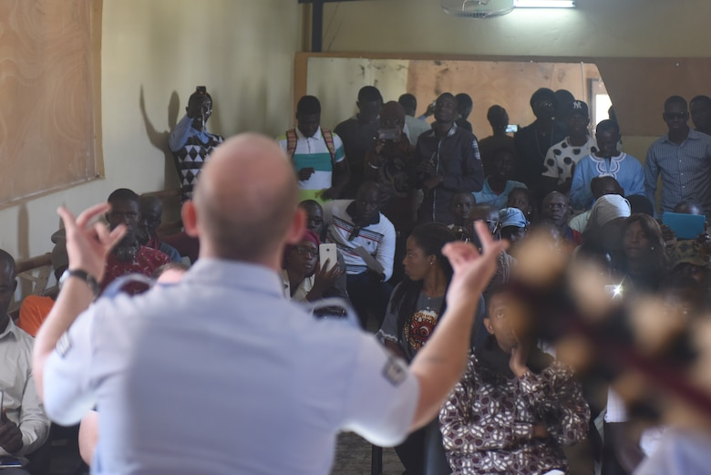 Staff Sgt. Denver Murphy, U.S. Air Forces in Europe Band vocalist, sings for students of the National School of the Arts in Dakar, Senegal, March 21, 2018. The visit to school was just one of the many community outreach events done by the band, who are in Dakar to support African Partnership Flight Senegal, which is U.S. Air Forces in Africa's premier security cooperation program with African partner nations to improve professional military aviation knowledge and skills. (U.S. Air Force photo by Airman 1st Class Eli Chevalier)