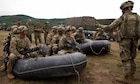 Combat engineers assigned to Regimental Engineer Squadron, 2d Cavalry Regiment learn how to load and off load a Zodiac boat