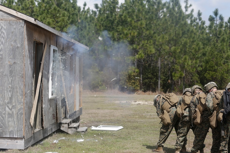 U.S. Marines from different units detonate a window charge during an Urban Breaching range at Camp Lejeune, N.C., March 20, 2018. Marines performed urban breaching exercises to gain hands-on experience in conducting tactical maneuvers, as well as proper handling and making of explosive charges. The Marines are with 2nd Combat Engineer Battalion and 3rd Battalion, 6th Marine Regiment, 2nd Marine Division.