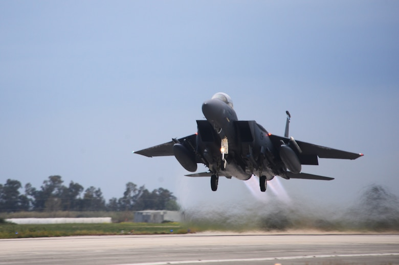 An F-15E Strike Eagle assigned to the 492nd Fighter Squadron, Royal Air Force Lakenheath, England takes off from Andravida Air Base, Greece, March 21, 2018, during exercise INIOHOS 18. The 492nd FS is flying alongside Hellenic Air Force airmen and other partners and Allies during the exercise to increase interoperability and strengthen partnerships. (U.S. Air Force photo/1st Lt. Elias Small)
