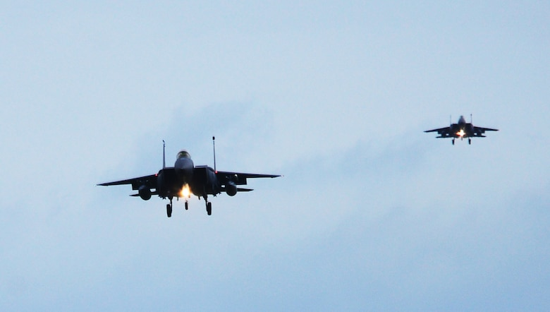 Two F-15E Strike Eagles assigned to the 492nd Fighter Squadron, Royal Air Force Lakenheath, England approach the runway at Andravida Air Base, Greece, March 21, 2018, during exercise INIOHOS 18. Thirteen 492nd FS F-15Es are participating in the Hellenic Air Force-led multinational exercise. (U.S. Air Force photo/1st Lt. Elias Small)