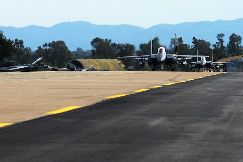 Two F-15E Strike Eagles assigned to the 492nd Fighter Squadron, Royal Air Force Lakenheath, England taxis at Andravida Air Base, Greece, March 21, 2018, during exercise INIOHOS 18. Thirteen 492nd Fighter Squadron F-15Es are participating in the Hellenic Air Force-led multinational exercise. (U.S. Air Force photo/1st Lt. Elias Small)