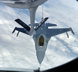 A Royal Netherlands Air Force F-16 prepares to receive fuel from a U.S. Air Force KC-135 Stratotanker during an aerial refueling training mission March 21, 2018, over the Netherlands. The F-16 flew in a formation with U.S. Air Force F-15C Eagles from the 142nd Fighter Wing, Portland, Oregon, operating from Leeuwarden Air Base, Netherlands, as part of a Theater Security Package in support of Operation Atlantic Resolve. (U.S. Air Force photo by Senior Airman Luke Milano)