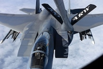 A U.S. Air Force F-15C Eagle receives fuel from a U.S. Air Force KC-135 Stratotanker during an aerial refueling training mission March 21, 2018, over the Netherlands. The F-15Cs deployed from the 142nd Fighter Wing, Portland, Oregon, and the 104th Fighter Wing, Westfield, Massachusetts, are operating from Leeuwarden Air Base, Netherlands, as part of a Theater Security Package in support of Operation Atlantic Resolve. (U.S. Air Force photo by Senior Airman Luke Milano)