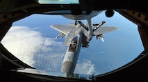 A U.S. Air Force F-15C Eagles receives fuel from a U.S. Air Force KC-135 Stratotanker during an aerial refueling training mission March 21, 2018, over the Netherlands. The F-15Cs deployed from the 142nd Fighter Wing, Portland, Oregon, and the 104th Fighter Wing, Westfield, Massachusetts, are operating from Leeuwarden Air Base, Netherlands, as part of a Theater Security Package in support of Operation Atlantic Resolve. (U.S. Air Force photo by Senior Airman Luke Milano)
