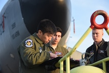 U.S. Air Force Capt. Daniel Ha, 351st Air Refueling Squadron aircraft commander, conducts a pre-flight brief prior to an aerial refueling training mission over the Netherlands with U.S. Air Force F-15C Eagles and Royal Netherlands Air Force F-16s March 21, 2018 on RAF Mildenhall, England. The F-15Cs are from the 142nd Fighter Wing, Portland, Oregon, and the 104th Fighter Wing, Westfield, Massachusetts, are operating from Leeuwarden Air Base, Netherlands, as part of a Theater Security Package in support of Operation Atlantic Resolve. (U.S. Air Force photo by Senior Airman Luke Milano)