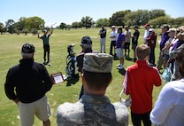 Brian Henninger, Professional Golfers' Association champion player, provides golfing tips to Keesler personnel during a free clinic at the Bay Breeze Golf Course March 20, 2018, on Keesler Air Force Base, Mississippi. Henninger is a two-time PGA and three-time nationwide tour champion and this is the first time he has held a clinic at Keesler. (U.S. Air Force photo by Kemberly Groue)