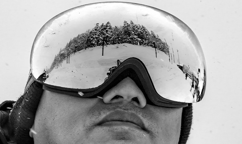 A participant in the 374th Force Support Squadron Outdoor Recreation trip to Myoko-Suginohara ski resort looks over forested terrain Feb. 11, 2017, in the Niigata prefecture, Japan. Skiing and snowboarding trips from Outdoor Recreation range from one to multiple days and may include lessons from qualified skiers and snowboarders. (U.S. Air Force photo by Airman 1st Class Donald Hudson)