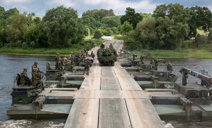 Battle Group Poland U.S. Soldiers and Lithuanian soldiers participate in a water crossing