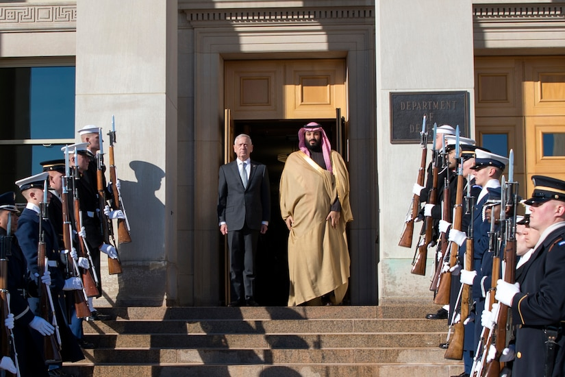 Defense Secretary James N. Mattis stands at the top of a staircase with Saudi Arabian Crown Prince Mohammed bin Salman.