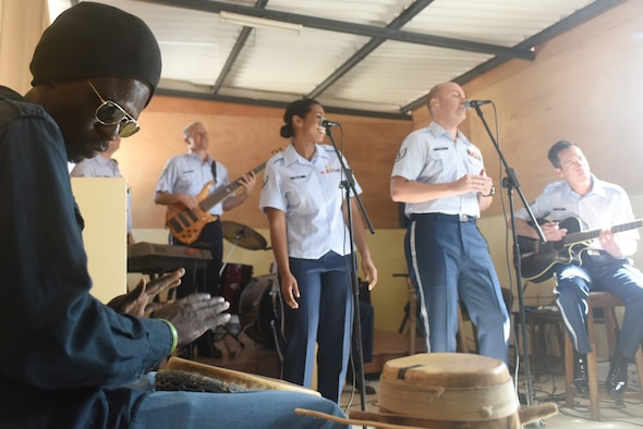 A student plays along with the U.S. Air Forces in Europe Band at the National School of the Arts in Dakar, Senegal, March 21, 2018. The USAFE Band assists in building relationships through community engagement and outreach. (U.S. Air Force photo by Airman 1st Class Eli Chevalier)