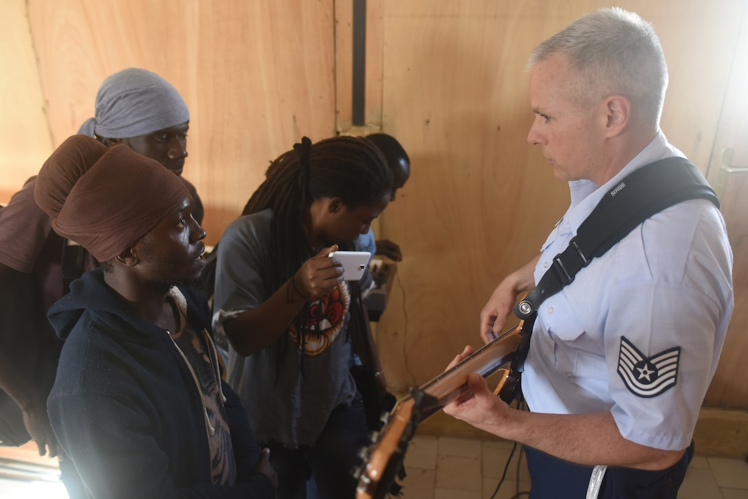 Tech. Sgt. Joseph Whitt teaches students bass guitar techniques at the National School of the Arts in Dakar, Senegal, March 21, 2018. The USAFE Band assists in building relationships through community engagement and outreach. (U.S. Air Force photo by Airman 1st Class Eli Chevalier)