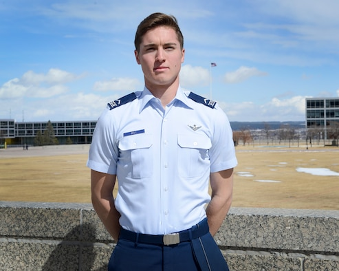 Cadet 3rd Class Jack Bell, Cadet Squadron 29, poses for a photo on the Terrazzo at the U.S. Air Force Academy, Colo., March 19, 2018. In the span of 72 hours, Bell talked a suicidal man off a Colorado Springs overpass and helped air traffic controllers in Northern California locate a downed aircraft. (U.S. Air Force photo by Staff Sgt. Charles Rivezzo)