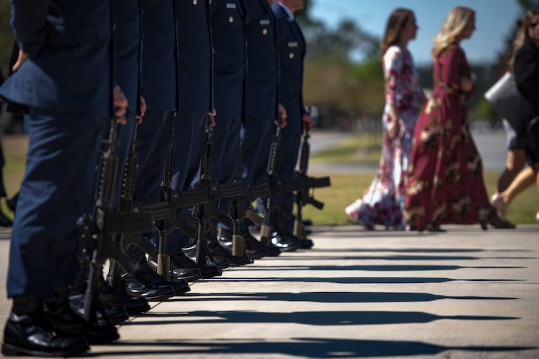Pararescuemen from the 38th Rescue Squadron stand ready to render a 21-gun salute following a memorial service in honor of Capt. Mark Weber, March 21, 2018, at Moody Air Force Base, Ga. Weber, a 38th RQS combat rescue officer and Texas native, was killed in an HH-60G Pave Hawk crash in Anbar Province, Iraq, March 15. During the ceremony, Weber was posthumously awarded a Meritorious Service Medal and the Air Force Commendation Medal. (U.S. Air Force photo by Staff Sgt. Ryan Callaghan)