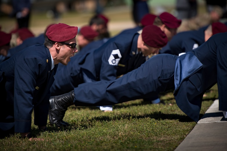 Pararescuemen perform memorial pushups following a memorial service in honor of Capt. Mark Weber, March 21, 2018, at Moody Air Force Base, Ga. Weber, a 38th Rescue Squadron combat rescue officer and Texas native, was killed in an HH-60G Pave Hawk crash in Anbar Province, Iraq, March 15. During the ceremony, Weber was posthumously awarded a Meritorious Service Medal and the Air Force Commendation Medal. (U.S. Air Force photo by Staff Sgt. Ryan Callaghan)