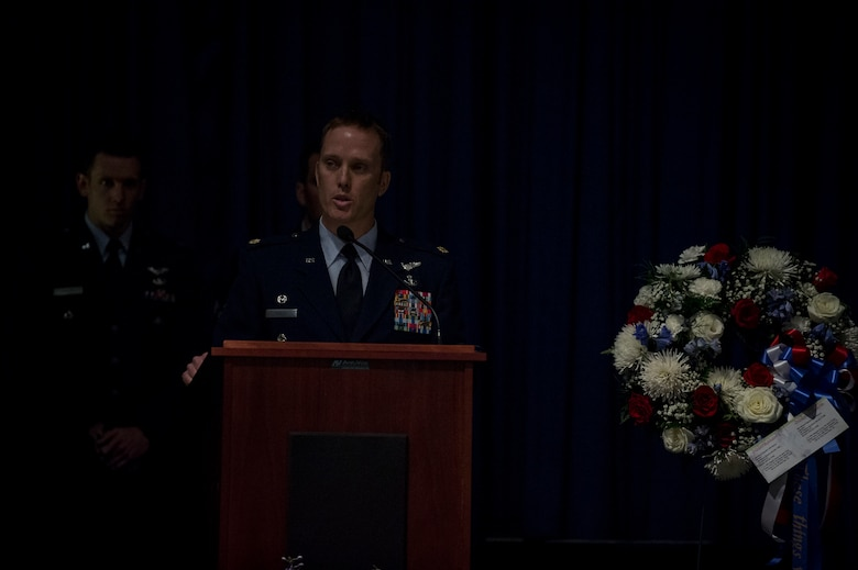 Maj. Jason Egger, 38th Rescue Squadron commander, speaks during a memorial service in honor of Capt. Mark Weber, March 21, 2018, at Moody Air Force Base, Ga. Weber, a 38th RQS combat rescue officer and Texas native, was killed in an HH-60G Pave Hawk crash in Anbar Province, Iraq, March 15. During the ceremony, Weber was posthumously awarded a Meritorious Service Medal and the Air Force Commendation Medal. (U.S. Air Force photo by Andrea Jenkins)