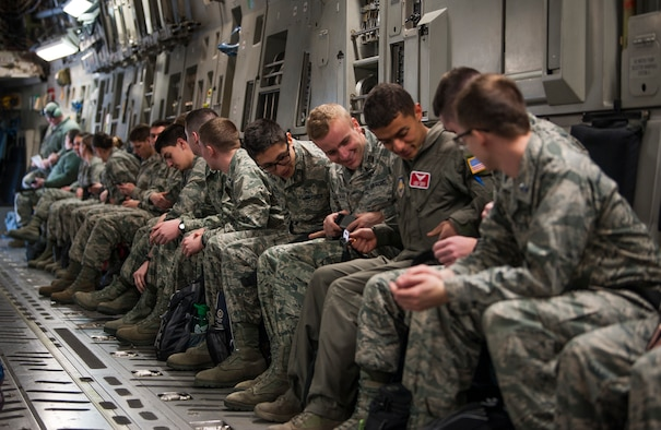 U.S. Air Force Reserve Officers Training Corps cadets assigned to Detachment 640 from Miami University, Ohio, fasten their seatbelts aboard a C-17 Globemaster III aircraft at Wright-Patterson AFB, Ohio, March 19, 2018.