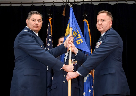 Col. John D. McKaye, 655th Intelligence, Surveillance and Reconnaissance Group commander, passes the guidon to Lt. Col. Jeffrey Derr, incoming 16th Intelligence Squadron commander, during a change of command ceremony March 10, 2018.