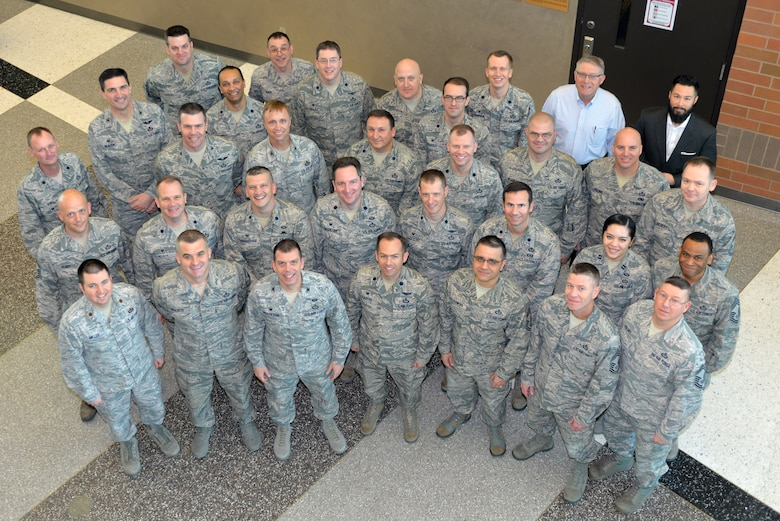 557th Weather Wing leadership stand in the atrium of the 557th WW headquarters building at the conclusion of the wing commanders' summit at Offutt Air Force Base, Neb., March 1, 2018. Squadron leaders from across the wing gathered to discuss leadership priorities, including weather operations, readiness, cyber operations and professional development. (U.S. Air Force photo by Paul Shirk)