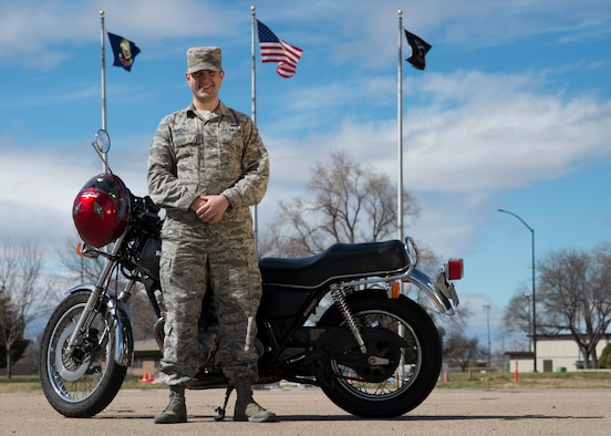 Senior Airman Alexander Hazzard, 366th Communications Squadron motorcycle safety representative, poses with his motorcycle March 21, 2018, at Mountain Home Air Force Base, Idaho. Motorcycle safety representatives use the Motorcycle Unit Safety Tracking Tool to manage how many Airmen ride motorcycles.
