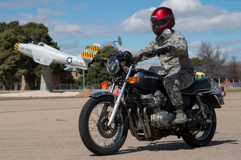 Senior Airman Alexander Hazzard, 366th Communications Squadron motorcycle safety representative, rides his motorcycle through Holt Park March 21, 2018, at Mountain Home Air Force Base, Idaho. The Air Force has extensive rules in place for motorcycle safety to ensure Airmen stay safe on the road.