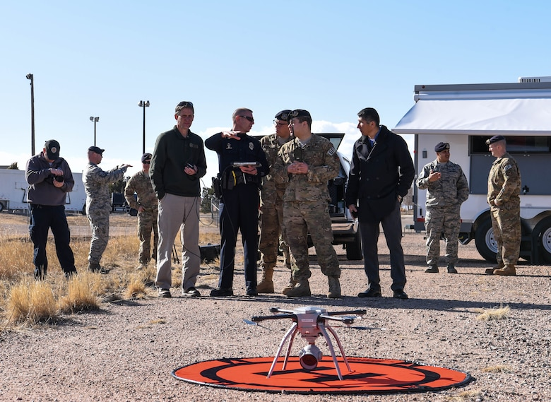 A group of Larimer County police officers converse with a security forces Airman during a flight demonstration at the counter unmanned aerial system Summit on F.E. Warren Air Force Base Wyo., March 13, 2018. Seven off-base federal agencies attended the event to cross-talk with security forces Airmen about their UAS programs. (U.S. Air Force photo by Airman 1st Class Braydon Williams)