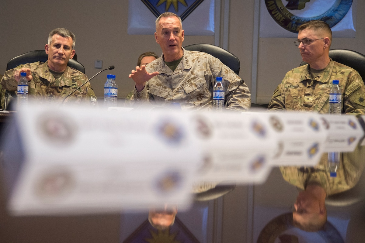 U.S. military leaders meet around a table.