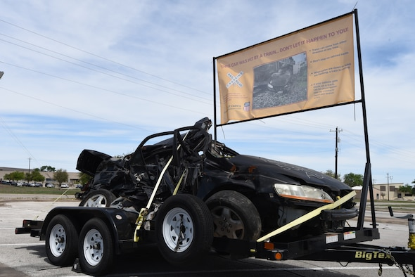 Union Pacific Railroad is showcasing a car demolished by a train near Liberty Drive at Laughlin Air Force Base, Texas. The car will be displayed until mid-May to raise awareness of train safety. (U.S. Air Force photo by Airman 1st Class Anne McCready)