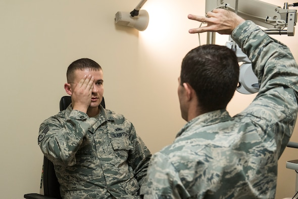 U.S. Air Force Staff Sgt. Stephen Spencer, 20th Aircraft Maintenance Squadron aerospace propulsion craftsman, covers his eye while Capt. John Kauderman, 20th Aerospace Medicine Squadron (AMDS) optometrist, tests his peripheral vision at Shaw Air Force Base, S.C., March 20, 2018.