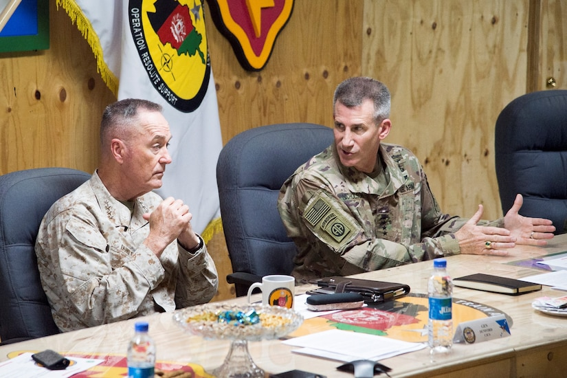 Chairman of Joint Chiefs of Staff and commander of NATO and U.S. forces in Afghanistan participate in a meeting.
