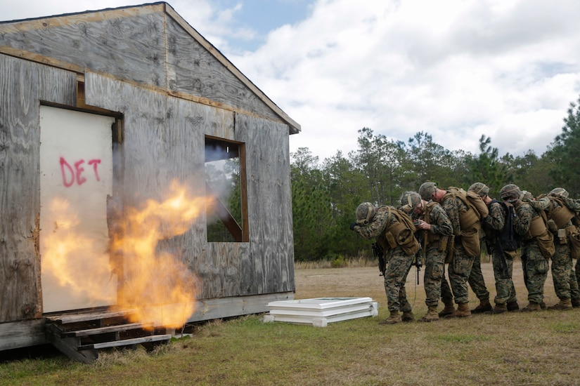 U.S. Marines from different units detonate a breaching charge during an urban breaching range at Camp Lejeune, N.C., March 20, 2018. Marines from both 2nd Combat Engineer Battalion and 3rd Battalion, 6th Marine Regiment, 2nd Marine Division conducted the training together to further improve proficiency in creating and using explosive breaching charges as well as improving unit cohesion.