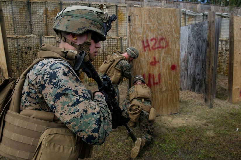 U.S. Marines from different units arm a breaching charge during an urban breaching range at Camp Lejeune, N.C., March 20, 2018. Marines from both 2nd Combat Engineer Battalion and 3rd Battalion, 6th Marine Regiment, 2nd Marine Division conducted the training together to further improve proficiency in creating and using explosive breaching charges as well as improving unit cohesion.