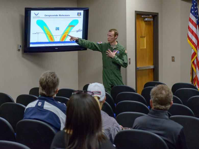 U.S. Air Force Capt. Will Simmons, 53rd Weather Reconnaissance Squadron pilot, briefs the purpose and function of the dropsonde used by hurricane hunters to the Professional Golf Association Tour attendees during the players' tour at the 53rd WRS building March 20, 2018, on Keesler Air Force Base, Mississippi. The attending golfers who are participating in the 2018 Rapiscan System Golf Classic also toured the military working dog kennel and received a Science on a Sphere demonstration. (U.S. Air Force photo by André Askew)