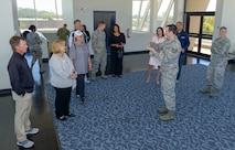 U.S. Air Force Tech. Sgt. Jacob Hail, 335th Training Squadron weather initial skills instructor, briefs the Professional Golf Association Tour champions and their wives during the Rapiscan System Golf Classic players' tour March 20, 2018, on Keesler Air Force Base, Mississippi. The attending golfers who are participating in the 2018 Rapiscan System Golf Classic also toured the 53rd Weather Reconnaissance Squadron and the military working dog kennel. (U.S. Air Force photo by André Askew)