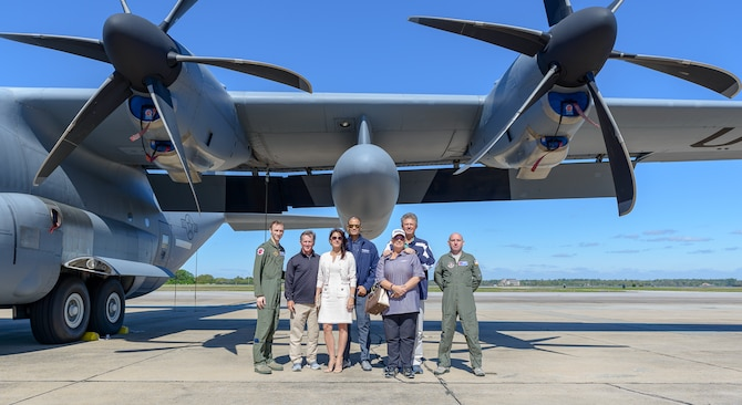 53rd Weather Reconnaissance Squadron pilots, Professional Golf Association Tour Champion players and the president of S2 Global Rapiscan Systems pose for a group photo in front of a WC-130J Super Hercules aircraft during the Rapiscan System Golf Classic players' tour March 20, 2018, on Keesler Air Force Base, Mississippi. The attending golfers who are participating in the 2018 Rapiscan System Golf Classic also toured the military working dog kennel and received a Science on a Sphere demonstration. (U.S. Air Force photo by André Askew)