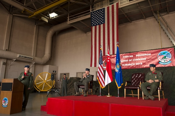 Lt. Col. Mark Whisler, 425th Fighter Squadron commander, addresses his predecessor during his acceptance speech after assuming command March 16, 2018, at Luke Air Force Base, Ariz. Whisler thanked Lt. Col. Jason Cooper for his work in leading and maintaining the squadron over the past two years. (U.S. Air Force photo/Senior Airman Ridge Shan)