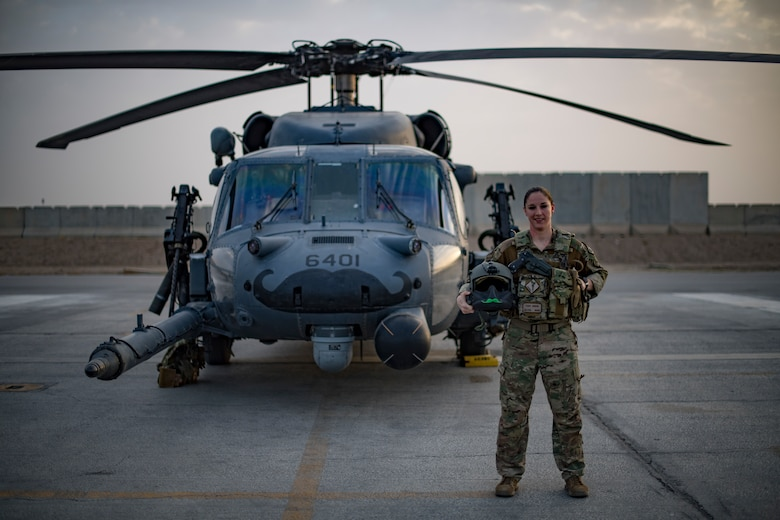 U.S. Air Force Capt. Victoria Snow, HH-60G Pave Hawk pilot, assigned to the 33rd Expeditionary Rescue Squadron, stands in front of her aircraft before a training mission with a Guardian Angel team assigned to the 308th ERQS, Kandahar Airfield, Afghanistan, in support of Operation Freedom's Sentinel and the NATO Resolute Support mission, March 13, 2018.