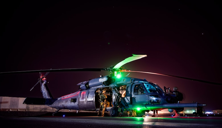 Aircrew members assigned to the 33rd and 308th Expeditionary Rescue Squadrons, prepare for a training mission with the HH-60G Pave Hawk at Kandahar Airfield, Afghanistan, in support of Operation Freedom's Sentinel and the NATO Resolute Support mission, Mar. 13, 2018.