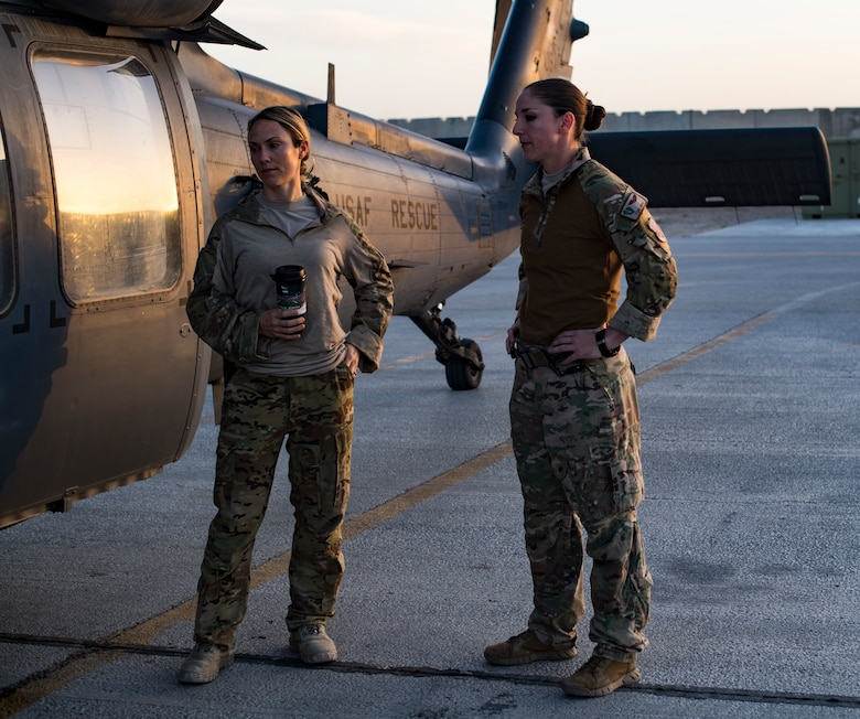 U.S. Air Force Maj. Margaret McCord, commander of the 33rd Expeditionary Rescue Squadron, and Capt. Victoria Snow, HH-60G Pave Hawk pilot assigned to the 33rd ERQS, discuss tactics in front of the aircraft after training mission with a Guardian Angel team assigned to the 308th ERQS, Kandahar Airfield, Afghanistan, March 13, 2018.