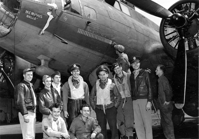 Maj Wyler (fourth from right) with some of the Memphis Belle crew.  Wyler flew two of his five combat missions on the Memphis Belle, including the crew's 25th mission.  This photograph was taken after that mission—crew chief MSgt Joseph Giambrone is painting on the 25th bomb.