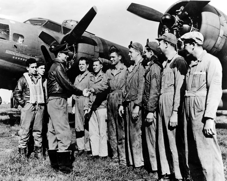 Capt. Robert Morgan, Memphis Belle pilot, thanking his ground crew.  (l to r) Cpl Oliver Champion, SSgt Max Armstrong, Sgt Ware Lipscomb, Sgt Leonard Sowers, Sgt Charles Blauser, Sgt Robert Walters, and crew chief MSgt Joseph Giambrone