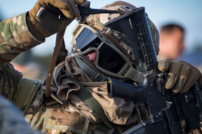 An Airman from the 824th Base Defense Squadron, removes their weapon during a Mission Readiness Exercise, March 16, 2018, at Joint Base McGuire-Dix Lakehurst, N.J. Evaluators tested the 824th BDS from Moody Air Force Base, Ga., and the 105th Security Forces Squadron from Stewart Air National Guard Base, N.Y., to ensure their combat readiness. (U.S. Air Force photo by Senior Airman Janiqua P. Robinson)