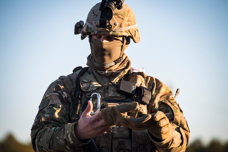 Senior Airman Bryan Bordelon, 824th Base Defense Squadron fireteam member, removes a glove during a Mission Readiness Exercise, March 13, 2018, at Joint Base McGuire-Dix Lakehurst, N.J. Evaluators tested the 824th BDS from Moody Air Force Base, Ga., and the 105th Security Forces Squadron from Stewart Air National Guard Base, N.Y., to ensure their combat readiness. (U.S. Air Force photo by Senior Airman Janiqua P. Robinson)